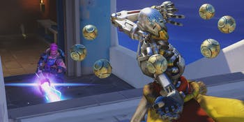 Zenyatta in 'Overwatch' with Zarya in the background.