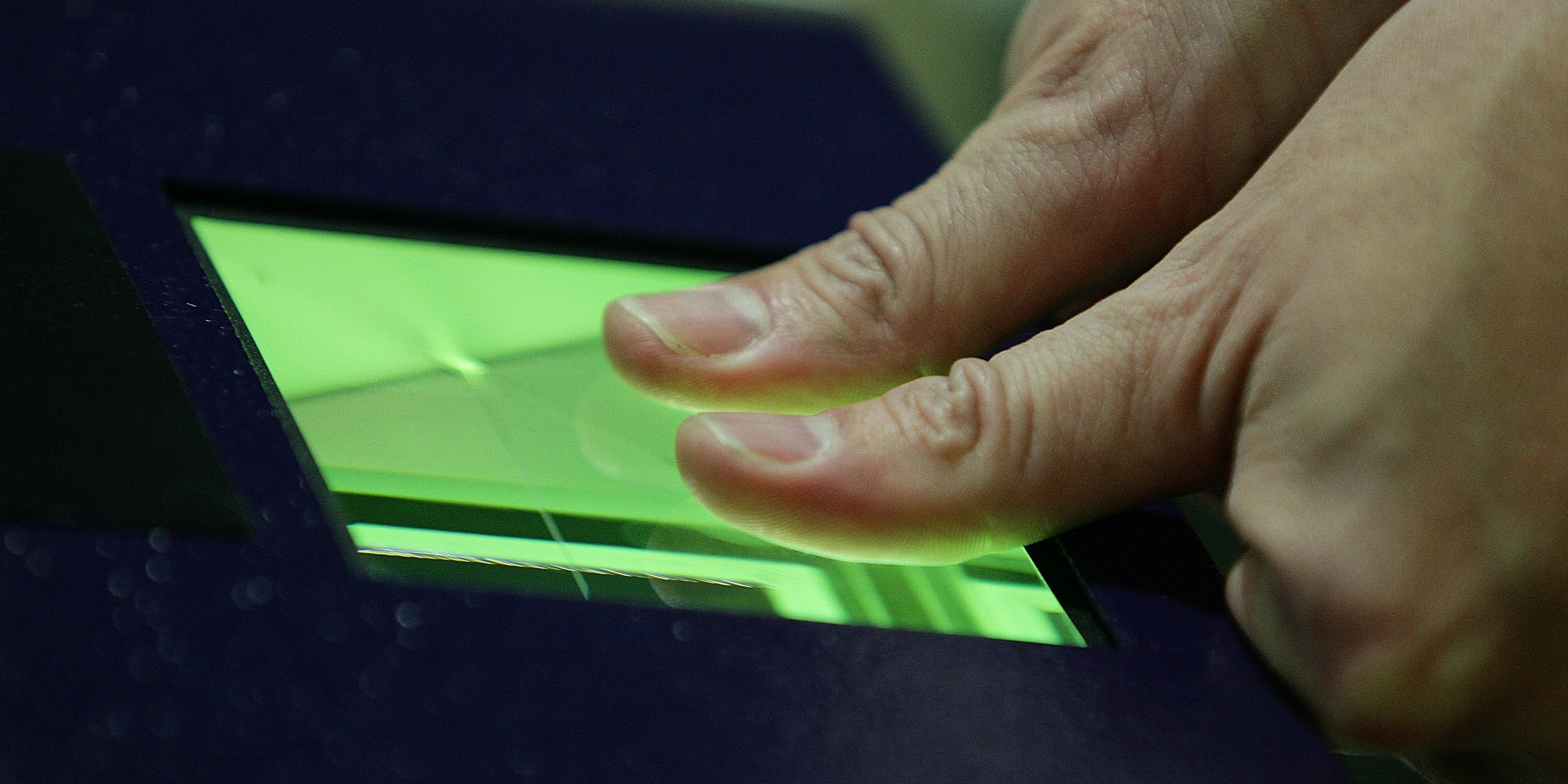 MANCHESTER, ENGLAND - NOVEMBER 16:  Home Office minister Phil Woolas has his fingerprints and photograph scanned as he enrols for the National Identity card at Manchester passport office on November 16, 2009 in Manchester, England. Mr Woolas, regional minister for the North West, is one of the first to enrol for the new biometric identity card which goes live for a trial in Manchester on November 30th.  (Photo by Christopher Furlong/Getty Images)