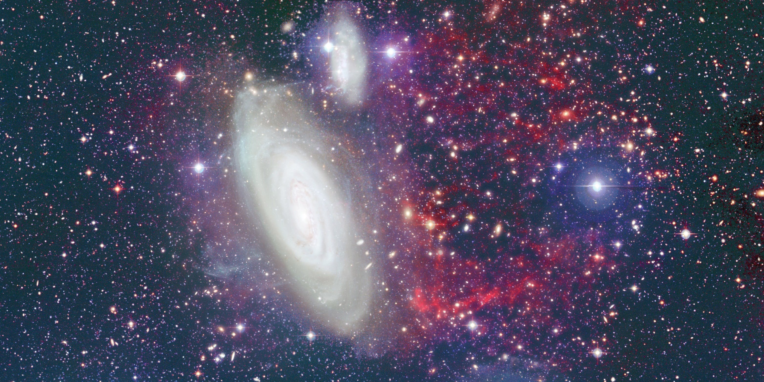 The foreground galaxy is NGC 4569 of the Virgo cluster.