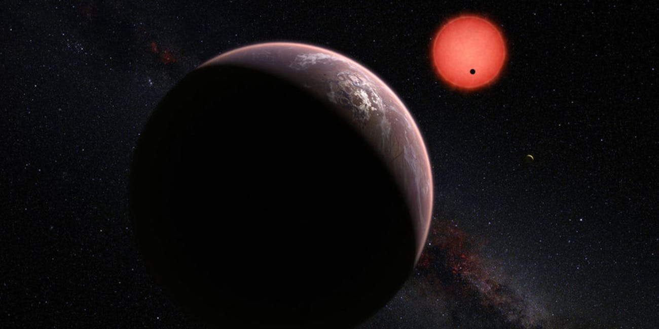 Artwork depicting planets orbiting a red dwarf star