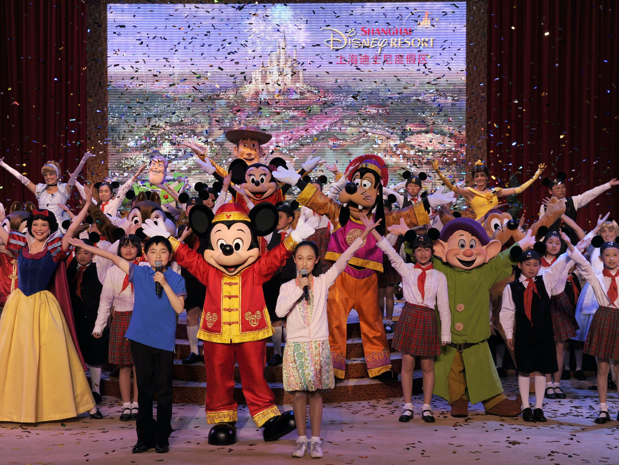 Dressed in a traditional Chinese costume, Mickey Mouse joins other Disney characters and a 50-voice Shanghai children's choir in Shanghai