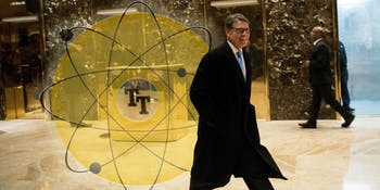Former Texas Governor Rick Perry walks through the lobby on his way out of Trump Tower.