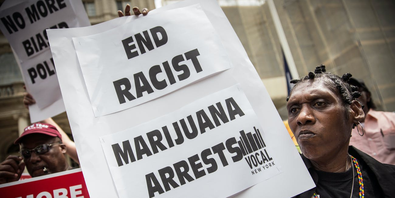 NEW YORK, NY - JULY 09: Elizabeth Owens protests on the steps of New York City Hall in support of the proposed Fairness and Equity Act, which would attempt to reform racially biased arrests in regards to marijuana possession in New York state on July 9, 2014 in New York City. New York State recently passed a new law allowing medical marijuana usage. (Photo by Andrew Burton/Getty Images)