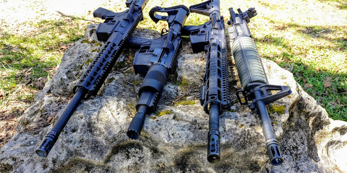 Modern AR-15 Rifles on a Rock