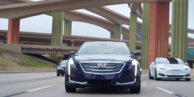 Cadillac driving down the road.