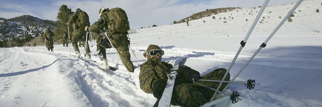 BRIDGEPORT, CA - DECEMBER 09: Marines with the 15th Marine Expeditionary Unit (MEU) Command Element learn to evacuate casualties using sleds and skis during training for winter conditions at the Marine Mountain Warfare Training Center on December 9, 2005 at the Marine Mountain Warfare Training Center near Bridgeport, California The 15th MEU is conducting mountain warfare training with the US Marine Corps' Infantry Officer's Course (IOC) in preparation for possible future missions in cold weather environments. It is the first major training exercise for the MEU since its return from deployment in June as well as the first time an entire MEU Command Element has conducted training with the IOC. The last deployment included a humanitarian assistance mission for Tsunami victims in Sri Lanka and combat operations in Iraq. (Photo by David McNew/Getty Images)