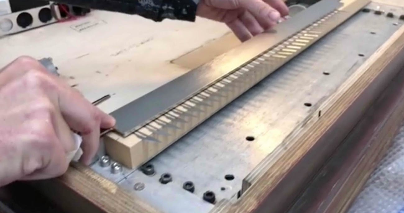 The video shows dozens of blades being placed inside the frame.