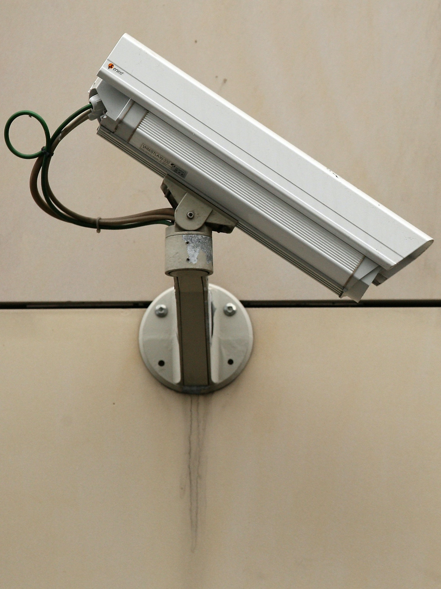 BERLIN, GERMANY - DECEMBER 18:  A security camera hangs on the street on December 18, 2012 in Berlin, Germany. After an attempted bombing at the main train station in Bonn, about whose planting on site security cameras were not able to provide sufficient footage as evidence, the German government is discussing increasing its public video surveillance.  (Photo by Adam Berry/Getty Images)