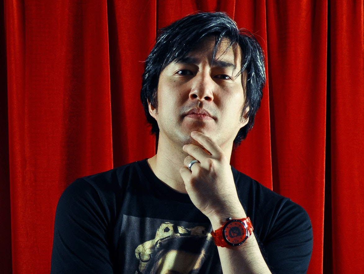 "Goichi ""Suda51"" Suda looks on imposingly, obviously thinking about game design."