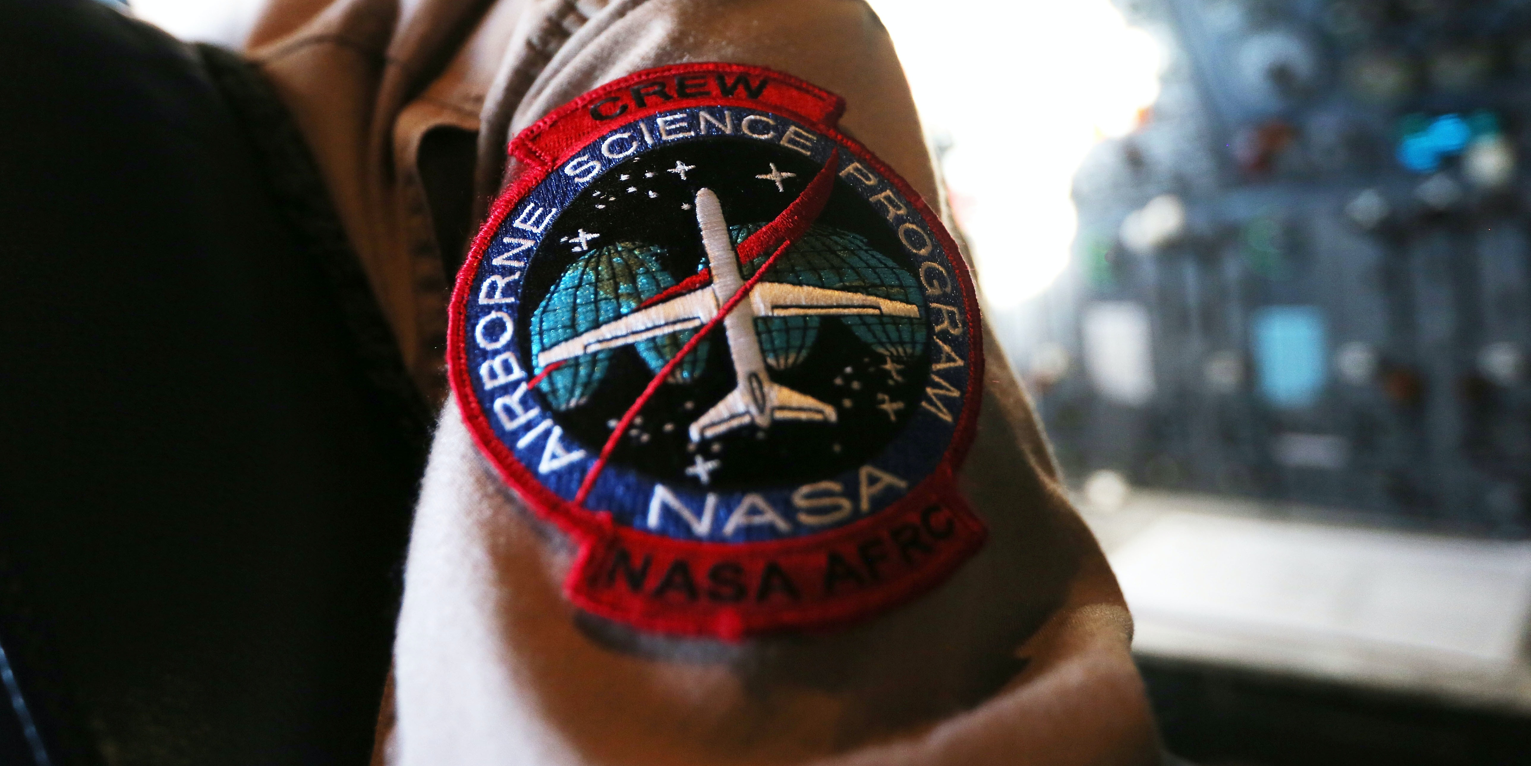 A NASA flight crew member works on Operation IceBridge, a study of polar ice. Mike Pence doesn't believe in climate change.