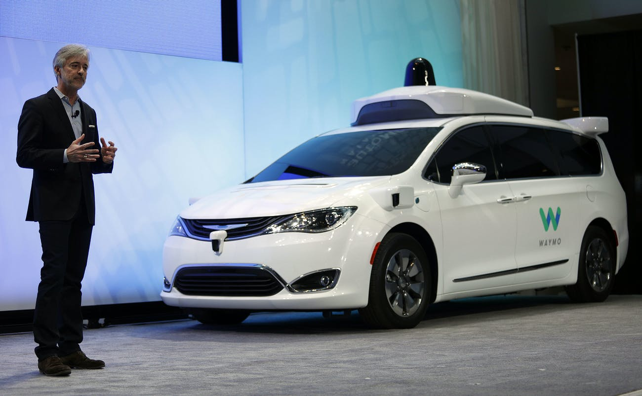 John Krafcik, CEO of Waymo, debuts a customized Chrysler Pacifica Hybrid that will be used for Google's autonomous vehicle program.