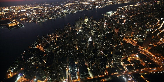 NEW YORK - SEPTEMBER 13:  Lower Manhattan is lit up as night falls September 13, 2009 in New York City.  (Photo by Mario Tama/Getty Images)