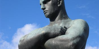 Arms crossed statue
