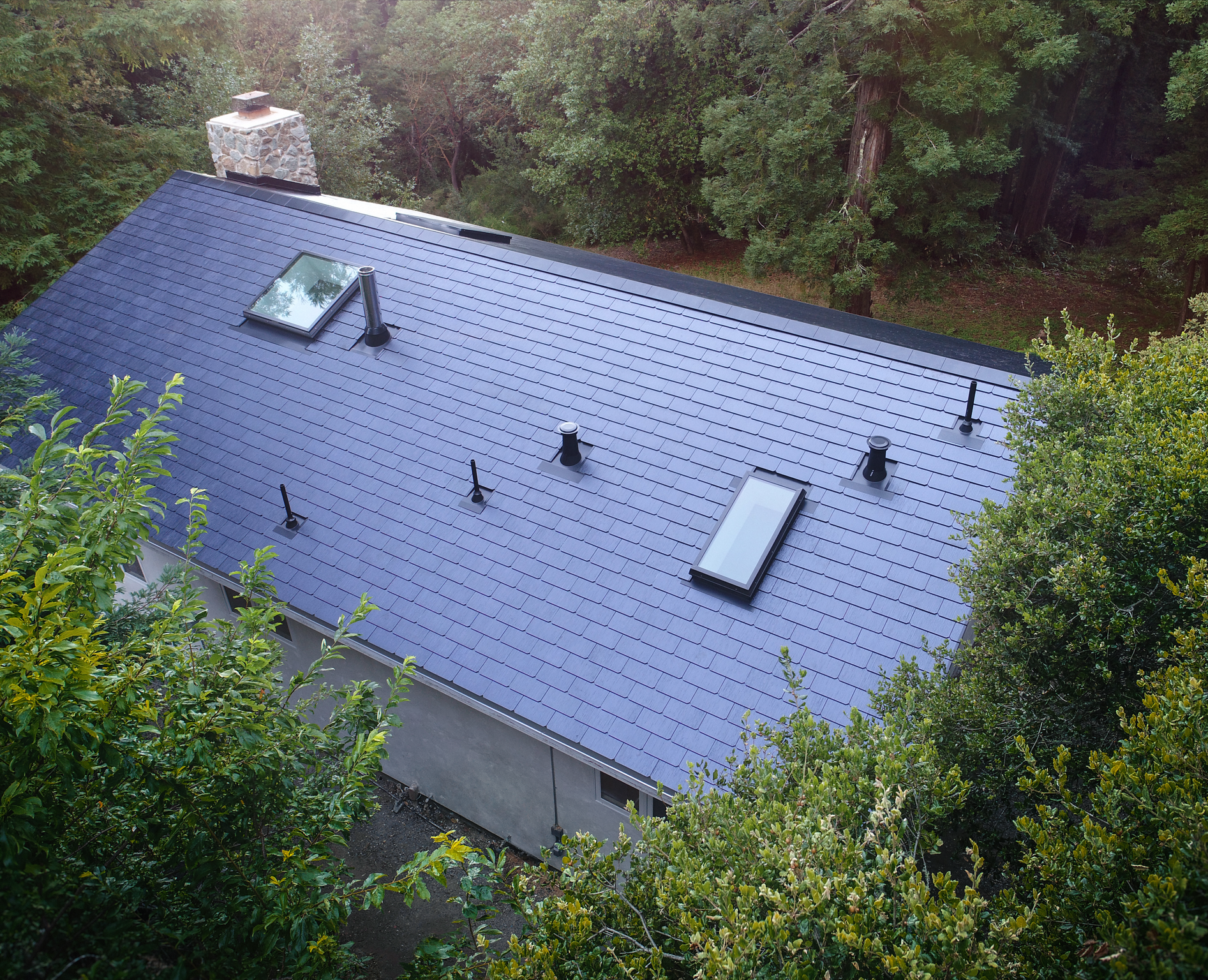 a birds eye view of the solar roof?auto=format%2Ccompress&w=700 here's how much one of tesla's amazing solar roofs actually costs Tesla Solar Shingles at readyjetset.co