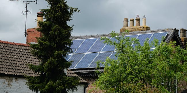 MALTON, ENGLAND - MAY 24: Solar panels can be seen attached to a property in the village of Kirby Misperton in North Yorkshire near the site of the KM8 fracking site on May 24, 2016 in Malton, England. North Yorkshire's Planning and Regulatory Committee voted seven to four in favour of a planning application submitted by Third Energy to carry out fracking at the KM8 site. Hydraulic fracturing, or fracking, is a technique designed to recover gas and oil from shale rock. (Photo by Ian Forsyth/Getty Images)