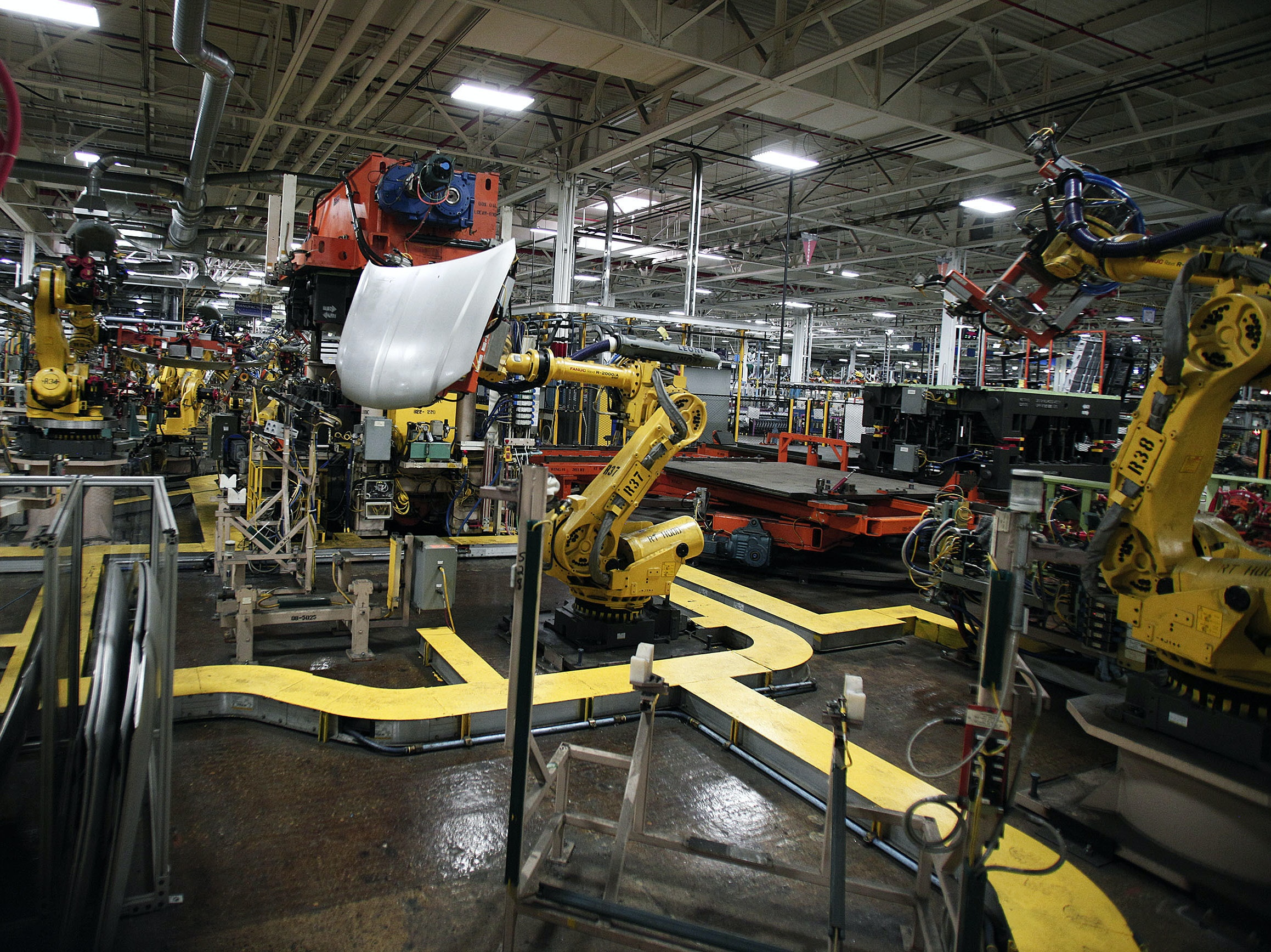 Robots handle parts for Fiat Chrysler Automobiles at the FCA Sterling Stamping Plant August in Sterling Heights, Michigan.