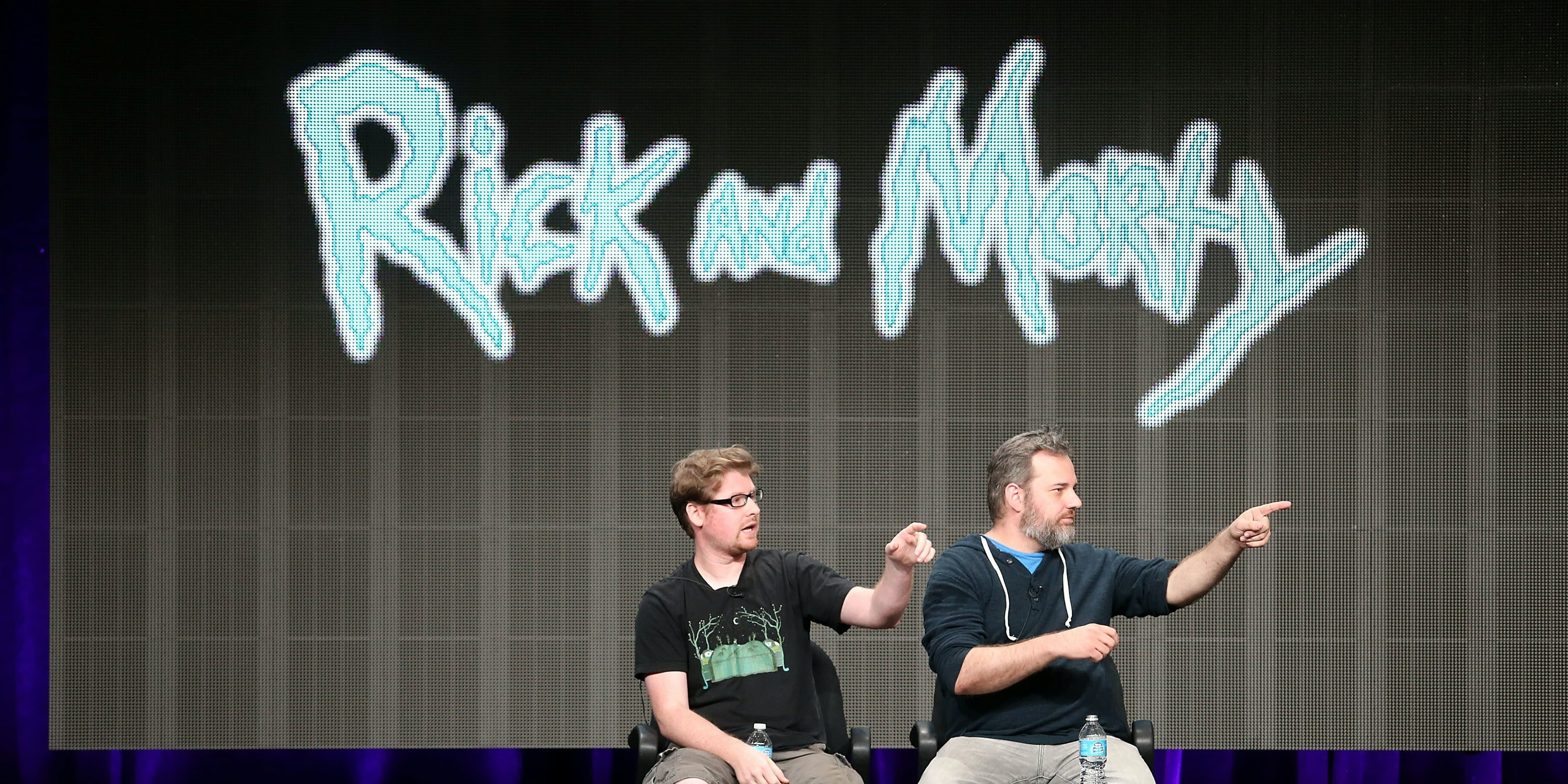 BEVERLY HILLS, CA - JULY 24:  Producers Justin Roiland (L) and Dan Harmon speak onstage during the Adult Swim: Rick and Morty panel at the Turner Broadcasting portion of the 2013 Summer Television Critics Association tour at the Beverly Hilton Hotel on July 24, 2013 in Beverly Hills, California.  (Photo by Frederick M. Brown/Getty Images)