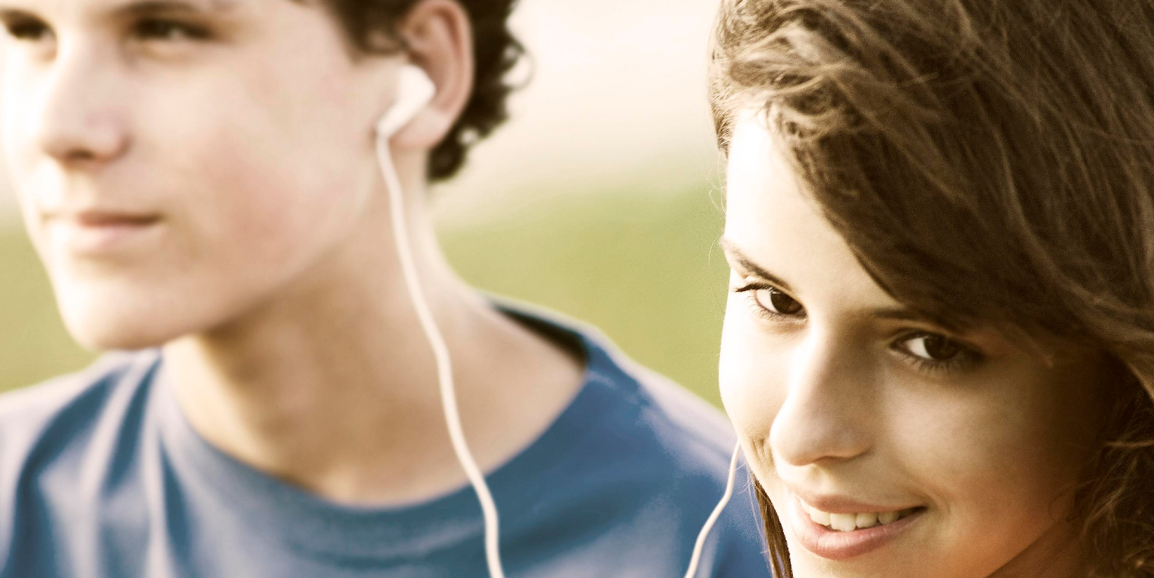 A couple listens to music together.