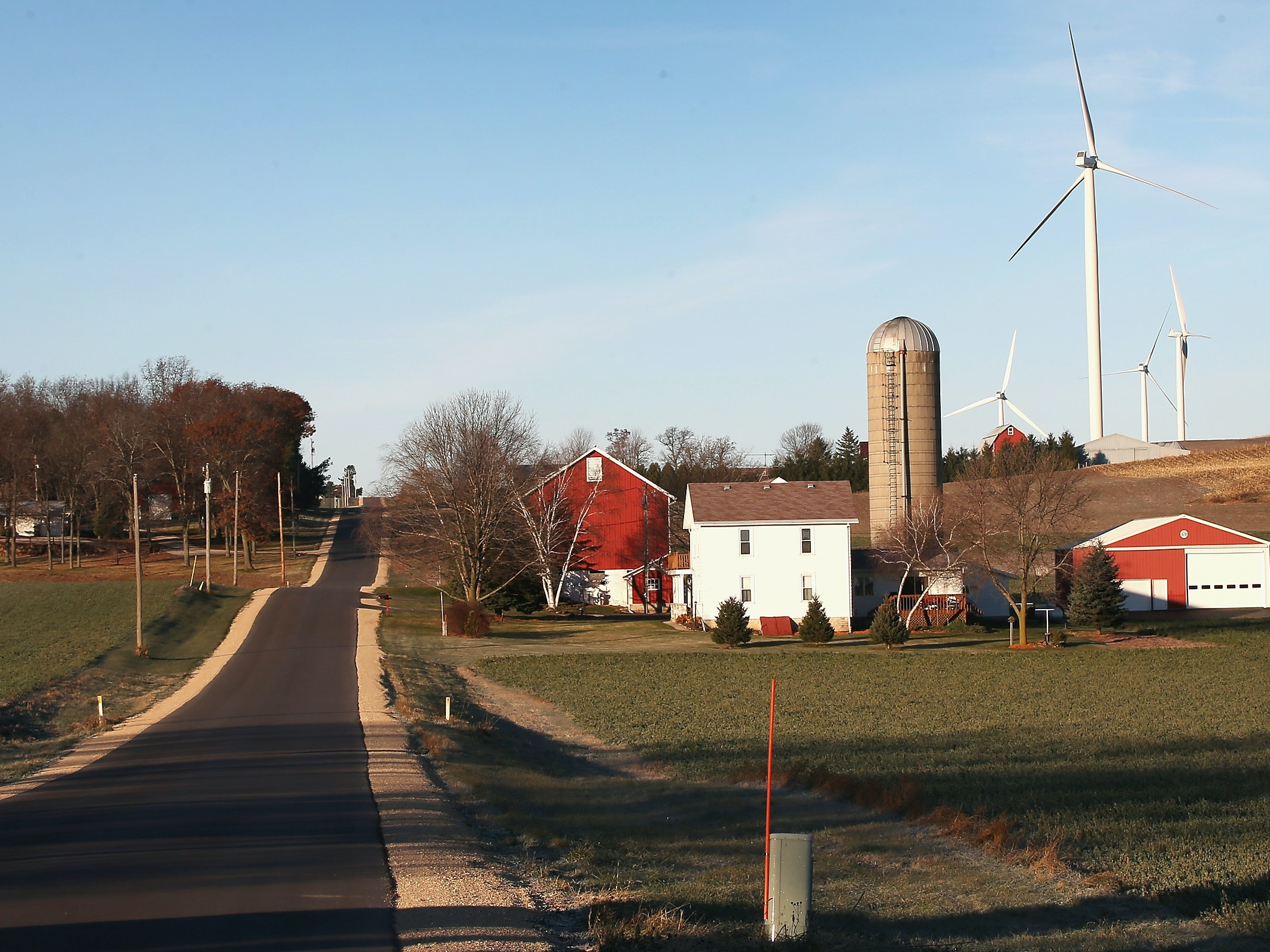 Wind turbines rise up above farmland on the outskirts of the Wisconsin state capital.