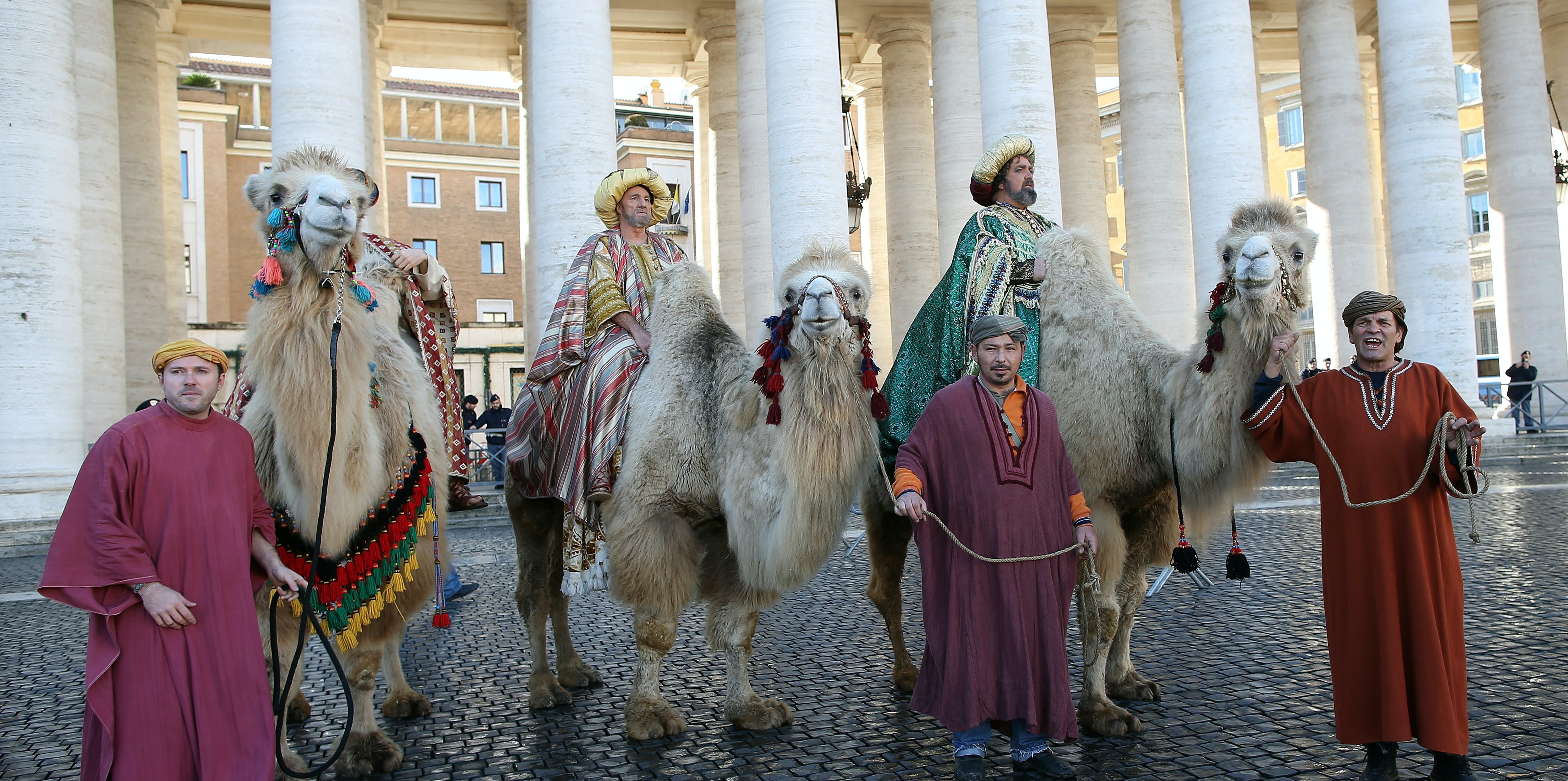 Faithful dressed as the three Magi (the Three Wise Men) gather in St Peter's Square during the Feast of the Epiphany attend the Pope Francis' Angelus blessing on January 6, 2016 in Vatican City, Vatican. In his homily at Mass celebrating the solemnity of the Epiphany, Pope Francis said the Church is called to be a missionary Church and announcing Christ is not a profession and nor is it about proselytism.