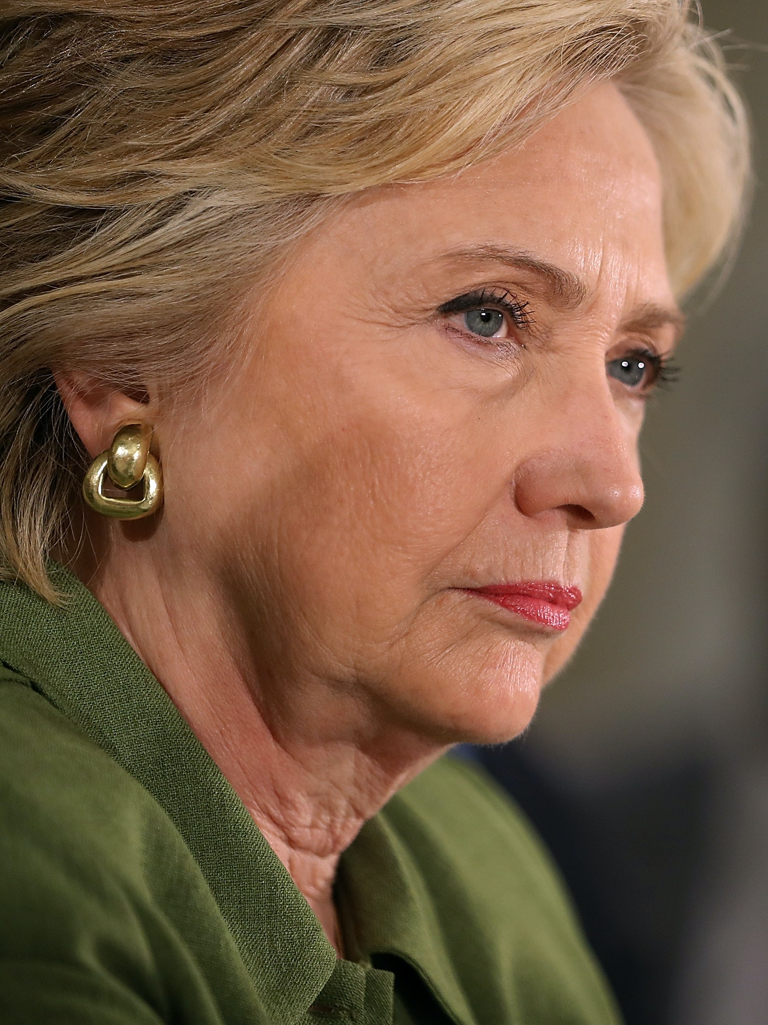 ORLANDO, FL - JULY 22:  Democratic presidential candidate former Secretary of State Hillary Clinton looks on during a round table discussion at Holden Heights Community Center on July 22, 2016 in Orlando, Florida. With three days to go until the Democratic National Convention, Hillary Clinton is campaigning in Florida.  (Photo by Justin Sullivan/Getty Images)
