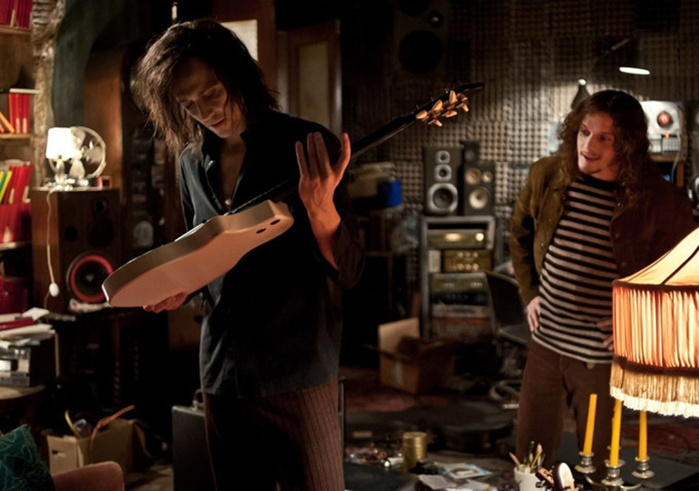 Adam (Tom Hiddleston) inspects an antique guitar in 'Only Lovers Left Alive'
