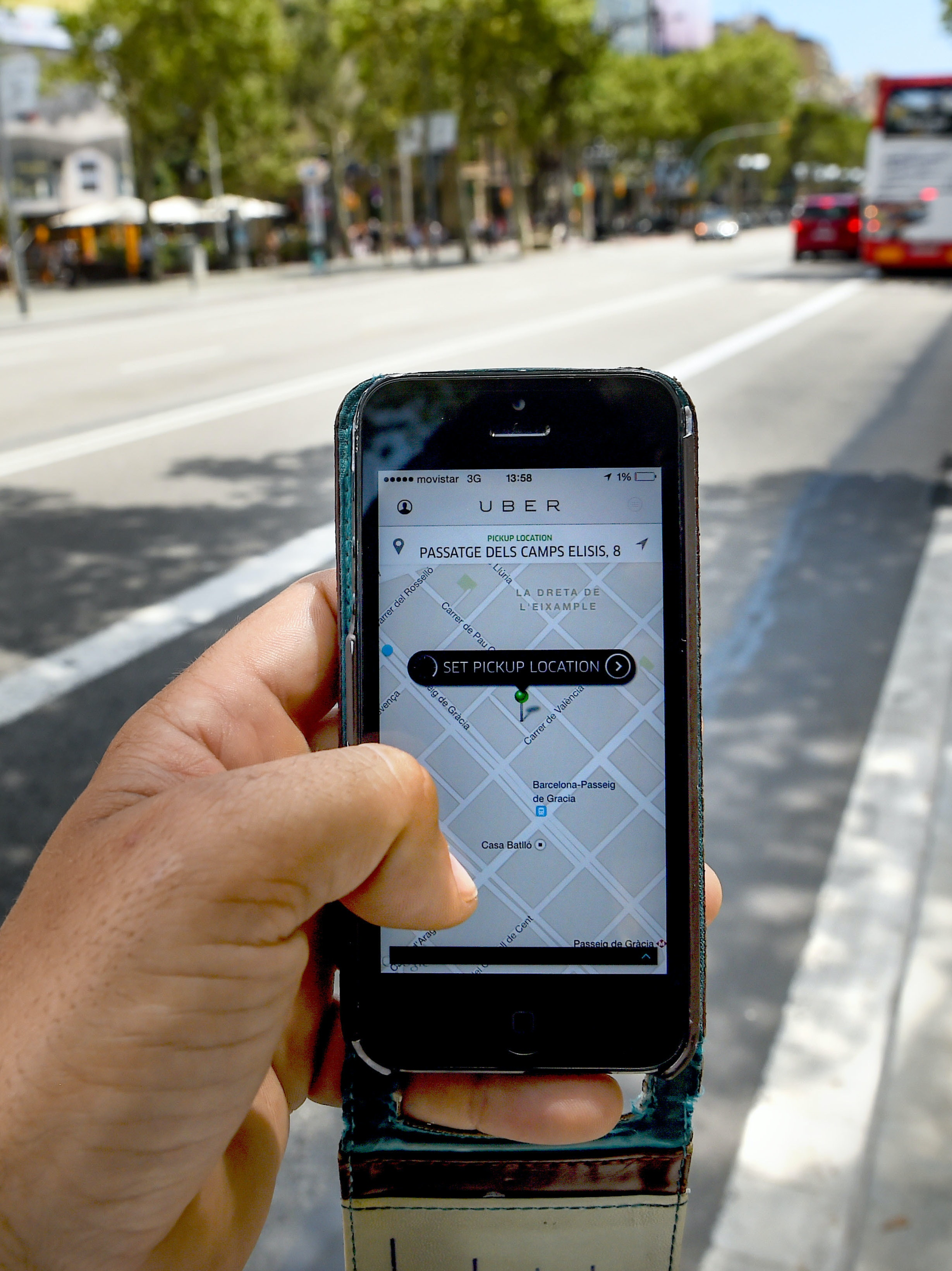 In this photo illustration, the new smart phone app 'Uber' shows how to select a pick up location on July 1, 2014 in Barcelona, Spain. Taxi drivers in main cities strike over unlicensed car-halling services. Drivers say that is a lack of regulation behind the new app.