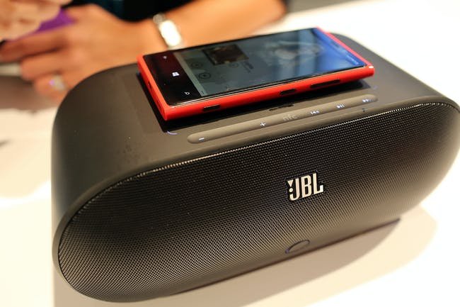A Nokia Lumia 920 charging on top of a speaker at a 2012 event using inductive charging.