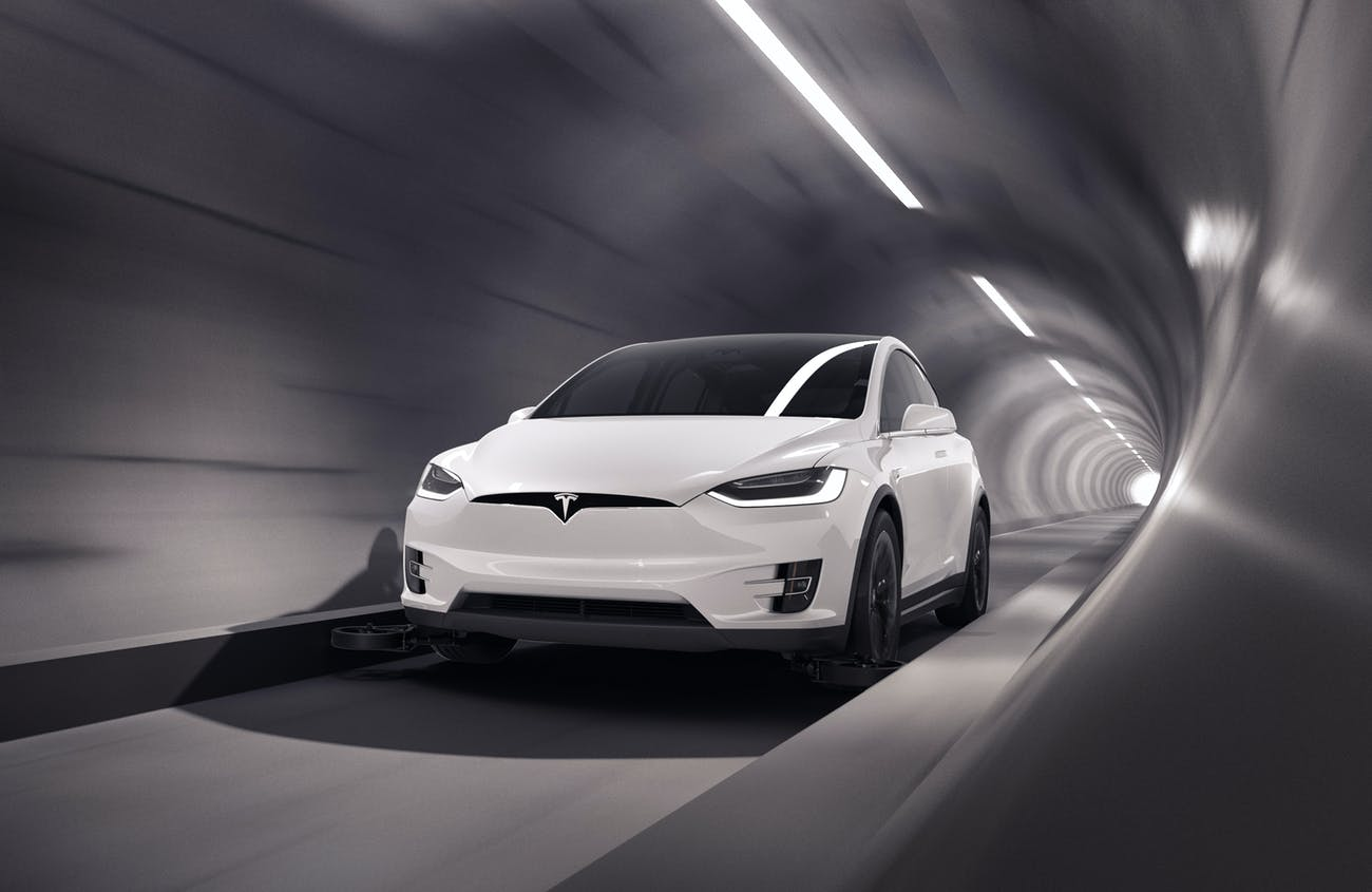 A Tesla Model X riding through The Boring Company's tunnel.