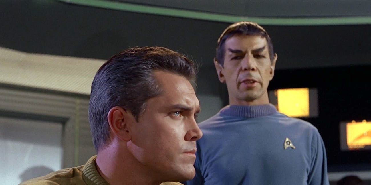 """Jeffrey Hunter as Captain Pike and Leonard Nimoy  as Spock in """"The Cage"""""""