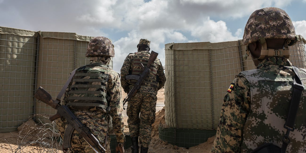 Soldiers in the 17th Battle Group of the Uganda People's Defense Force (UPDF) serving in the African Union Mission in Somalia (AMISOM) exit AMISOM's Forward Operating Base before a patrol on October 11, 2016 in Barawe, Somalia. The city of Barawe was a stronghold for the Al-Shabaab militant group in Somalia's southern coast, but were driven out by the Somali Government and AMISOM in 2014. Al-Shabaab continues to fight in the region with counter-insurgency tactics. Somalia is on the brink of its first parliamentary elections since 1984, but issues with security and disagreements in the election process have led to delays.