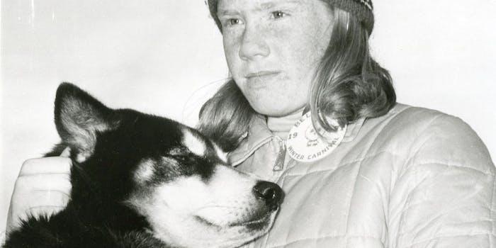 dog comforting girl
