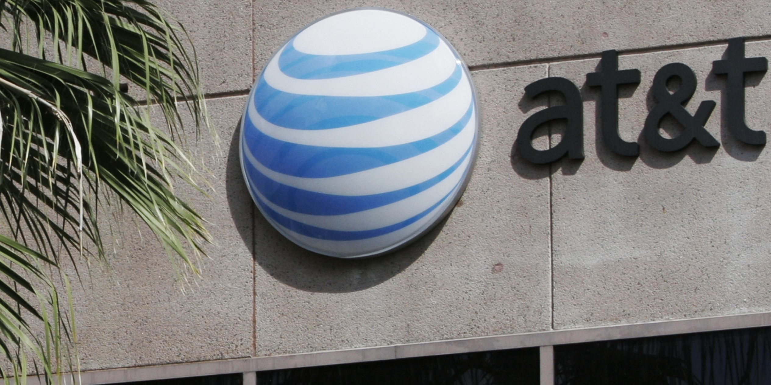 SAN ANTONIO, TX  - MARCH 6:  The AT&T Communications  Inc. corporate headquarters building is seen March 6, 2006 in San Antonio, Texas. AT&T announced plans to acquire BellSouth in a deal valued at approximately $67 billion.  (Photo by Toby Jorrin/Getty Images)