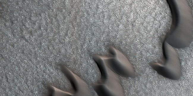 Martian sand dunes and boulder piles.