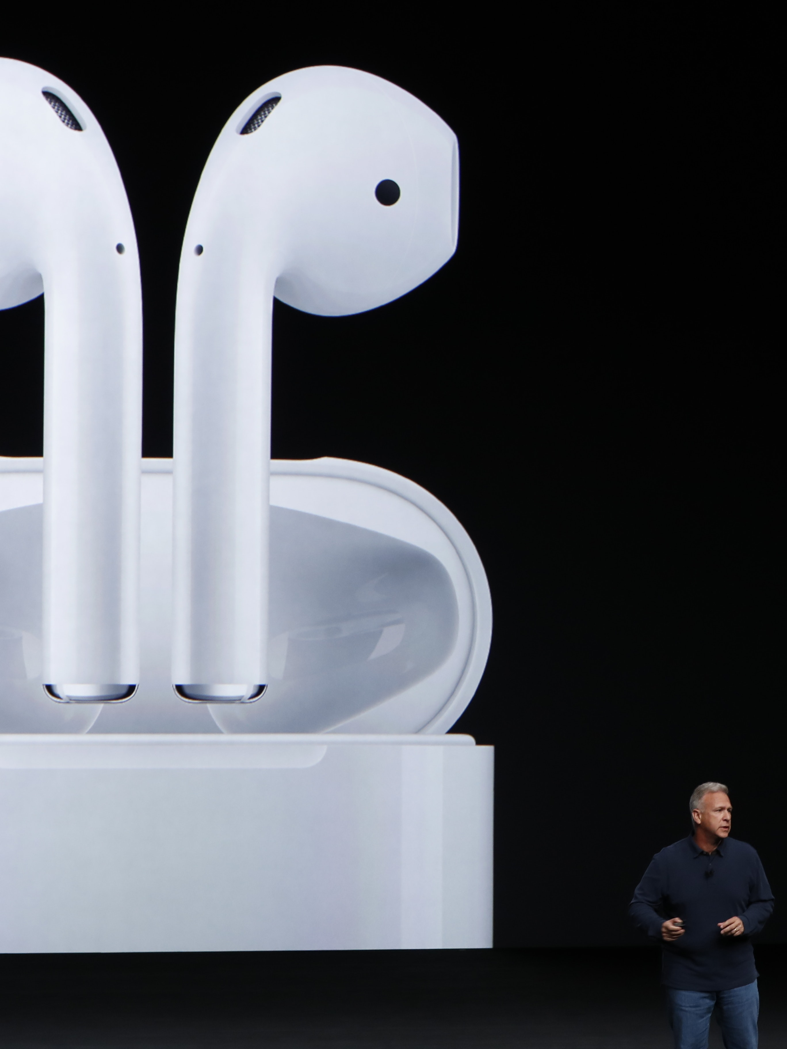 SAN FRANCISCO, CA - SEPTEMBER 07: Apple Senior Vice President of Worldwide Marketing Phil Schiller announces AirPods during a launch event on September 7, 2016 in San Francisco, California. Apple Inc. is expected to unveil latest iterations of its smart phone, forecasted to be the iPhone 7. The tech giant is also rumored to be planning to announce an update to its Apple Watch wearable device. (Photo by Stephen Lam/Getty Images)