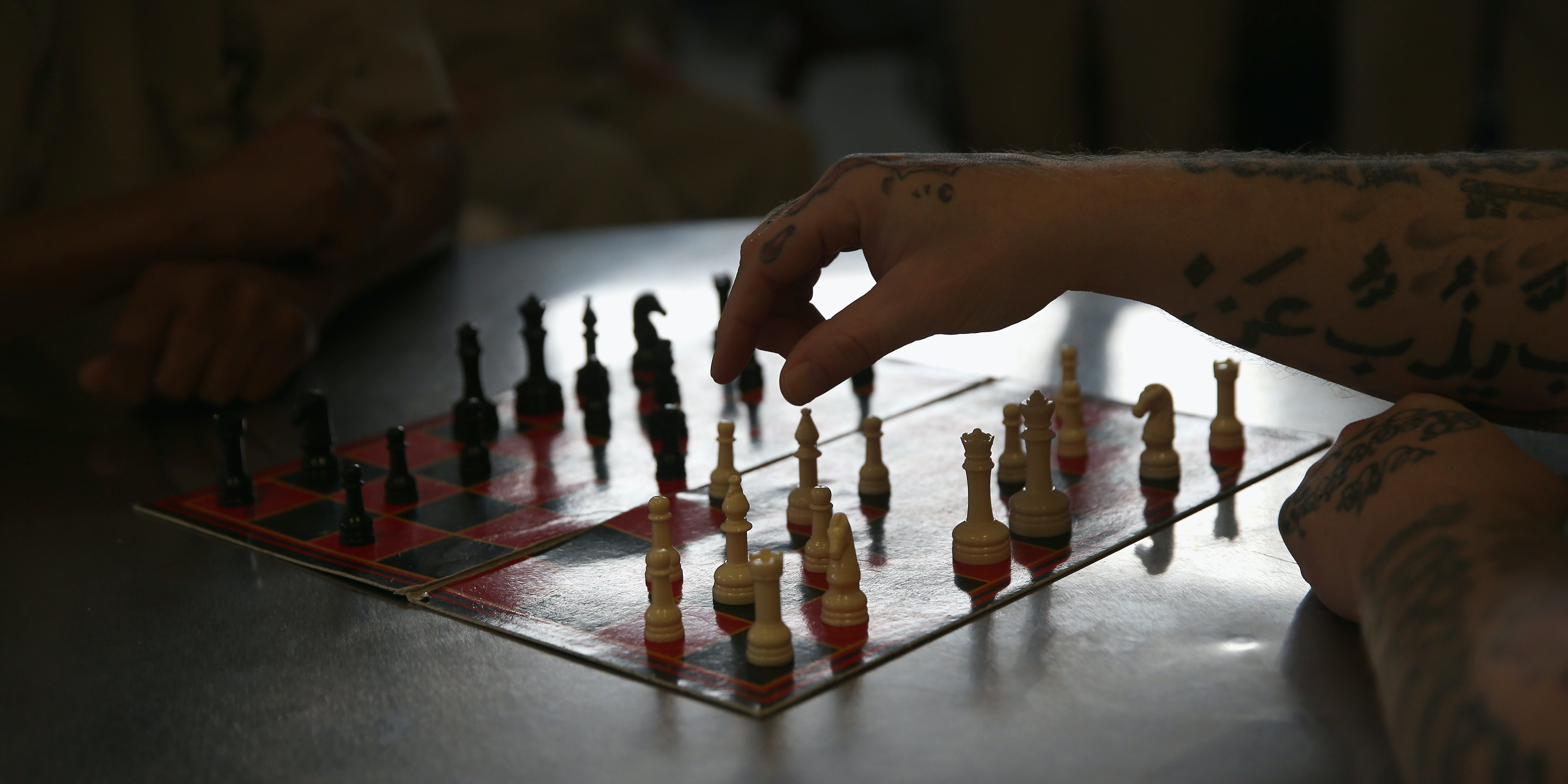 ENFIELD, CT - MAY 03:  Inmates play chess at the military Veterans Unit of the Cybulski Rehabilitation Center on May 3, 2016 in Enfield, Connecticut. The Veterans Unit houses some 110 prisoners, all U.S. military veterans convicted of crimes ranging from petty larceny to murder. Inmates at the center typically have less than two years left on their sentences. The unit is part of a Connecticut Department of Correction program to turn some prisons into reintegration centers to prepare inmates for successful re-entry into society. Criminal justice and prison reforms are taking hold with bi-partisan support nationwide in an effort to reduce prison populations and recidivism. The state's criminal justice reforms fall under Connecticut Governor Dannel Malloy's 'Second Chance Society' legislation.  (Photo by John Moore/Getty Images)