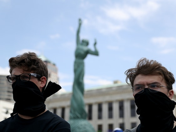 CLEVELAND, OH - JULY 18:  Protesters wear black masks during a 'Dump Trump' demonstration near the site of the Republican National Convention on July 18, 2016 in Cleveland, Ohio. Protestors are staging demonstrations outside of the Republican National Convention which starts on Monday July 18 and runs through July 21.  (Photo by Justin Sullivan/Getty Images)
