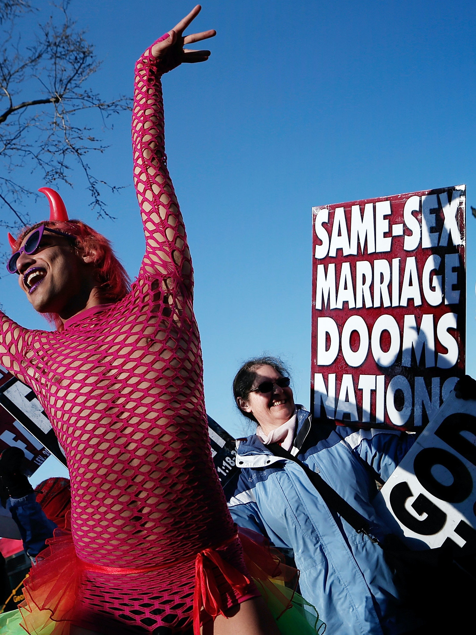 New York-based drag perform Qween Amor proudly dancing, surrounded by Westboro Baptist Church picketers