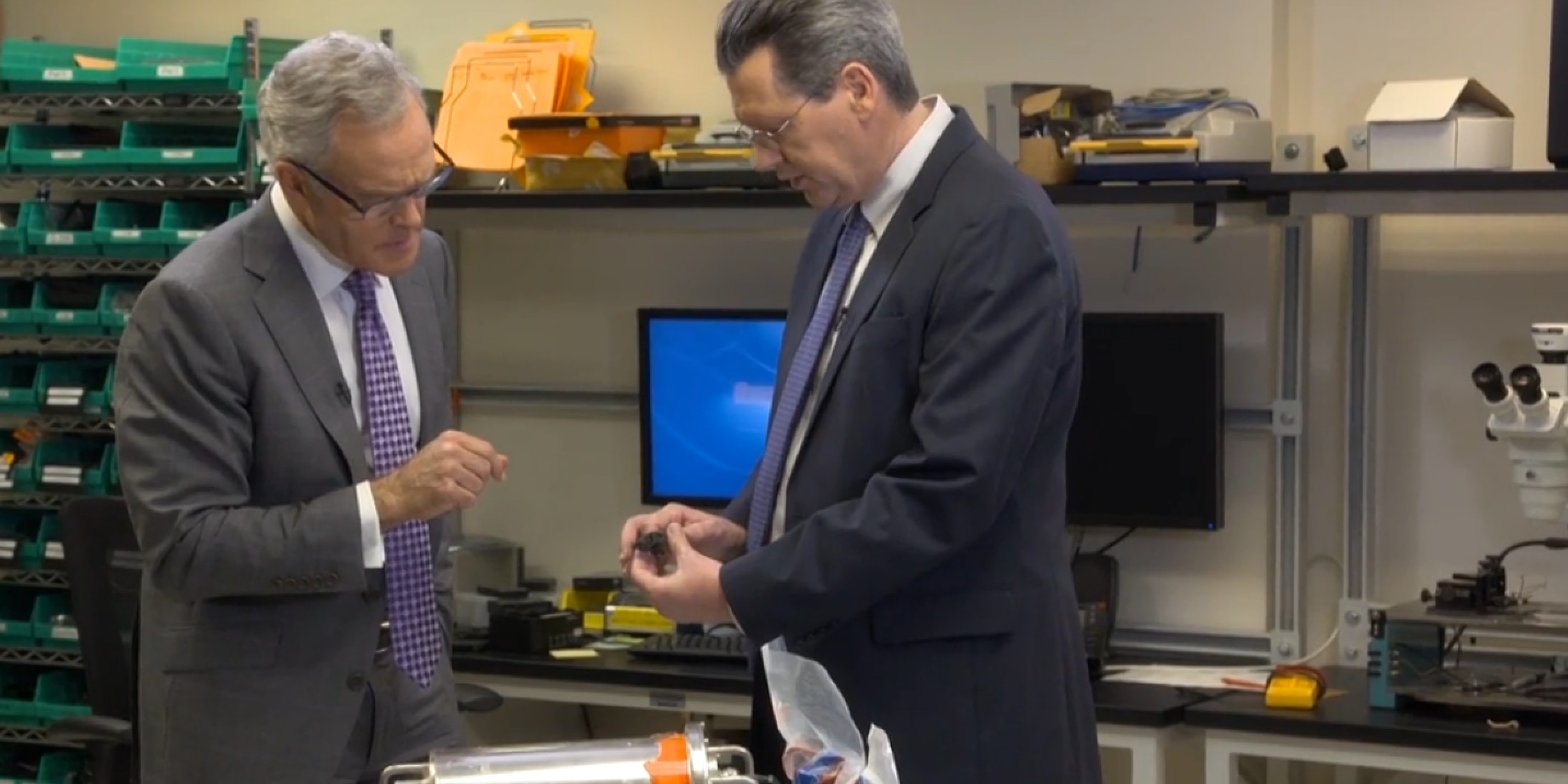 Jim Ritter, deputy director of the National Transportation Safety Board, shows '60 Minutes' correspondent Scott Pelley the voyage data recorder (VDR) recovered from El Faro.