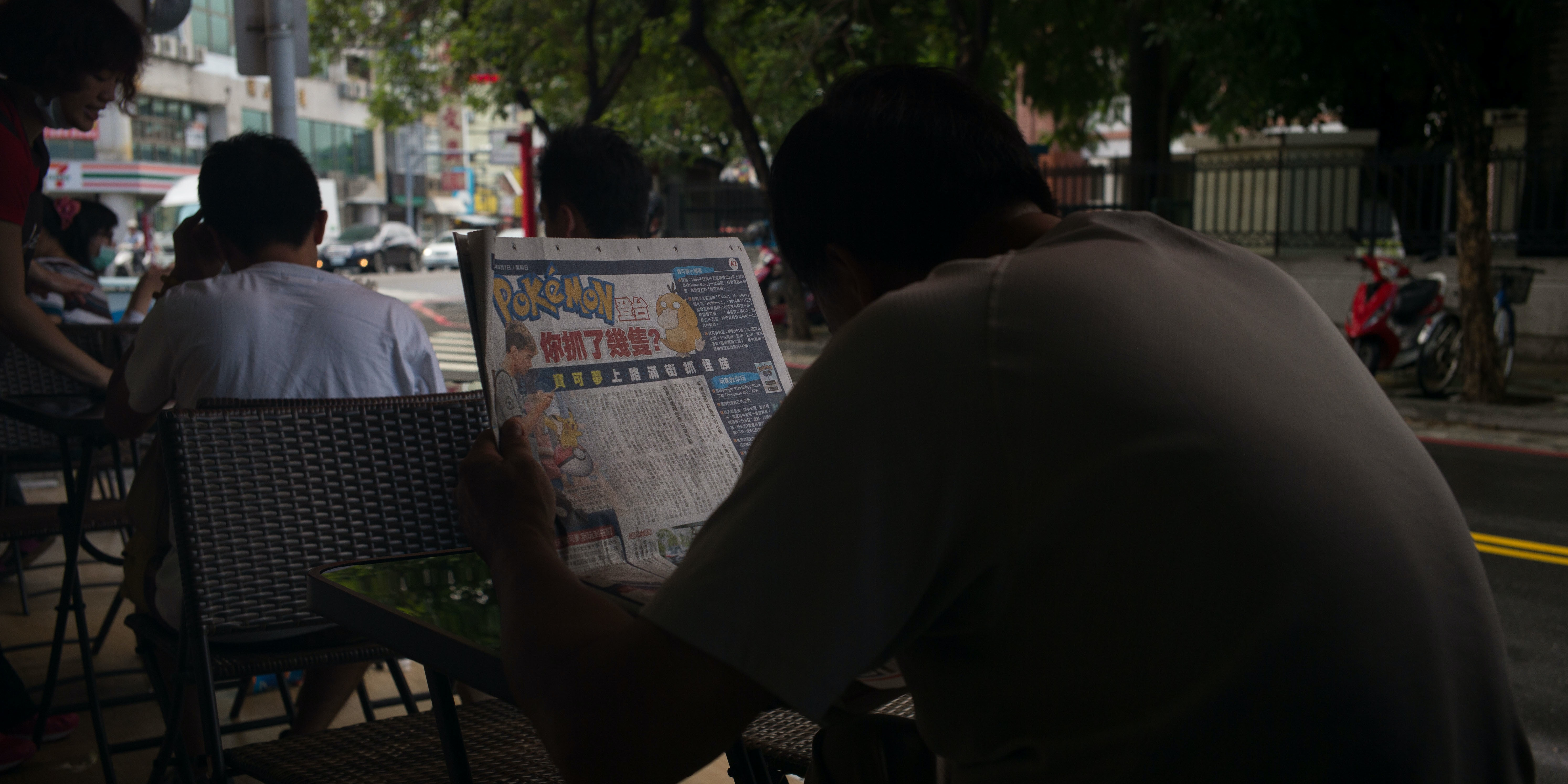 TAINAN, TAIWAN - AUGUST 08:  A man reads a Pokemon Go article in the newspaper on August 7, 2016 in Tainan, Taiwan. 'Pokemon Go,' which has been a smash-hit across the globe was launched in Taiwan on 6th August. Since its global launch, the mobile game has been an unexpected megahit among users who have taken to the streets with their smartphones.  (Photo by Billy H.C. Kwok/Getty Images)