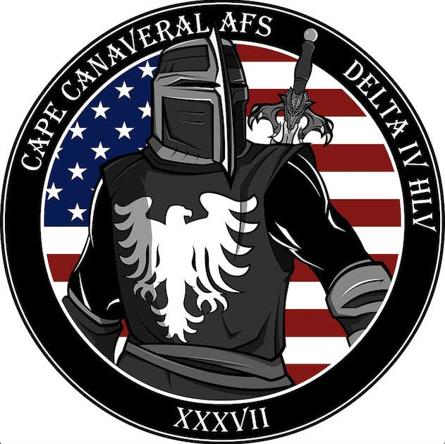 The NRO developed this logo this mission logo for the launch of the NROL-37 satellite. The knight stands in front of the U.S. flag in a defensive posture. The eagle on the chest represents freedom.