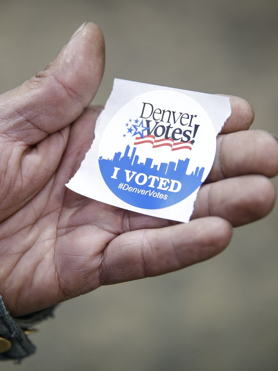 Charles Dominguez of Denver, Colorado grabs an 'I Voted' sticker after casting his ballot at the Denver Elections Division offices on November 8, 2016 in Denver, Colorado. After a contentious campaign season, Americans go to the polls today to choose the next president of the United States.