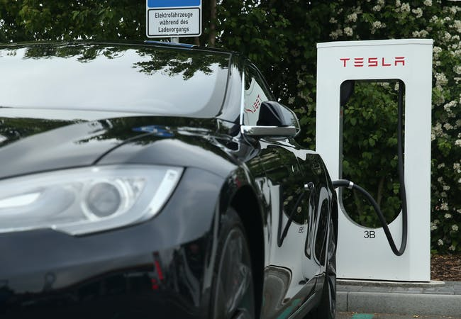 A Tesla vehicle charging up.