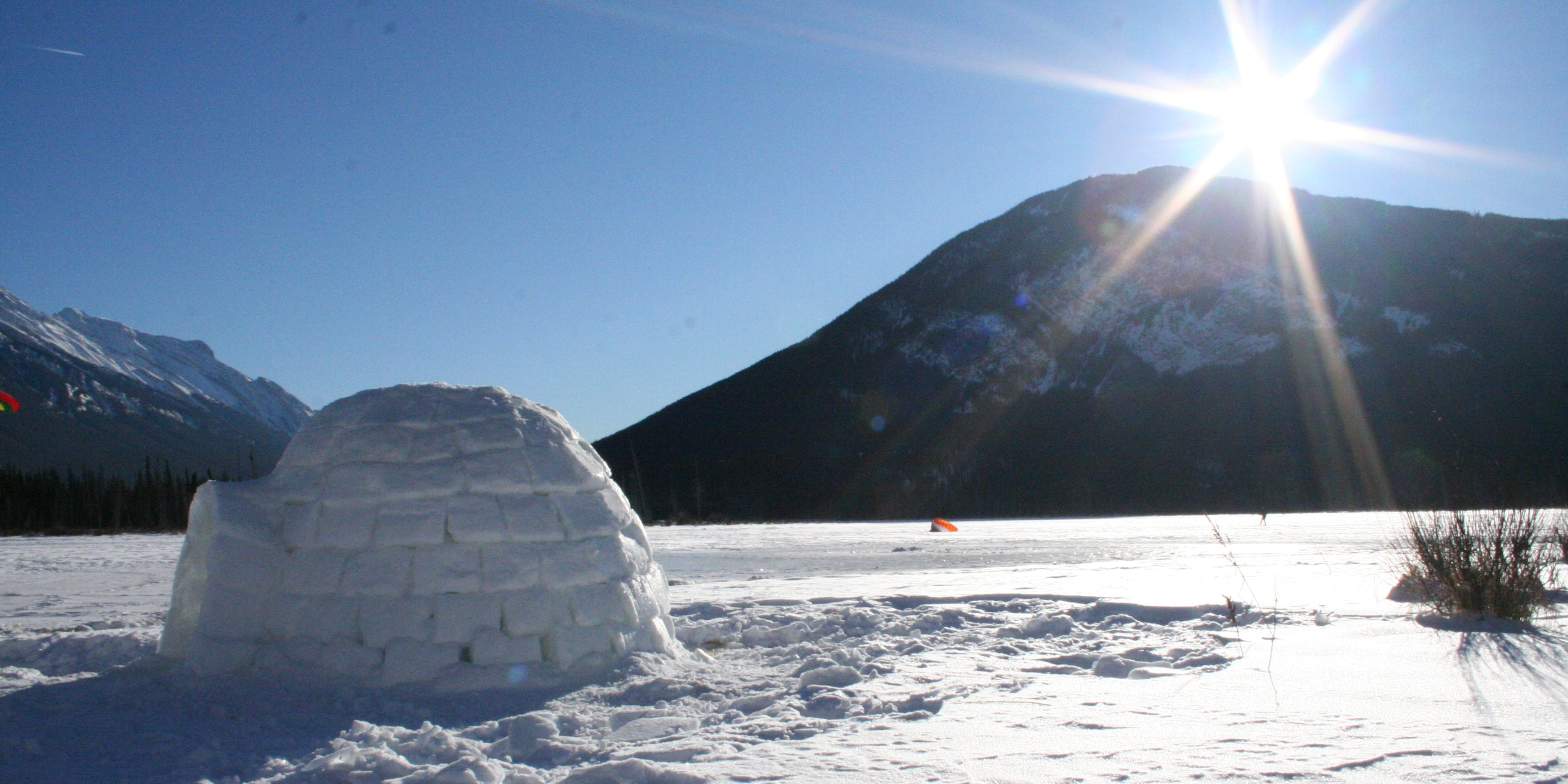 Improvised igloo building on the Vermillion Lakes outside Banff, Alberta Canada.