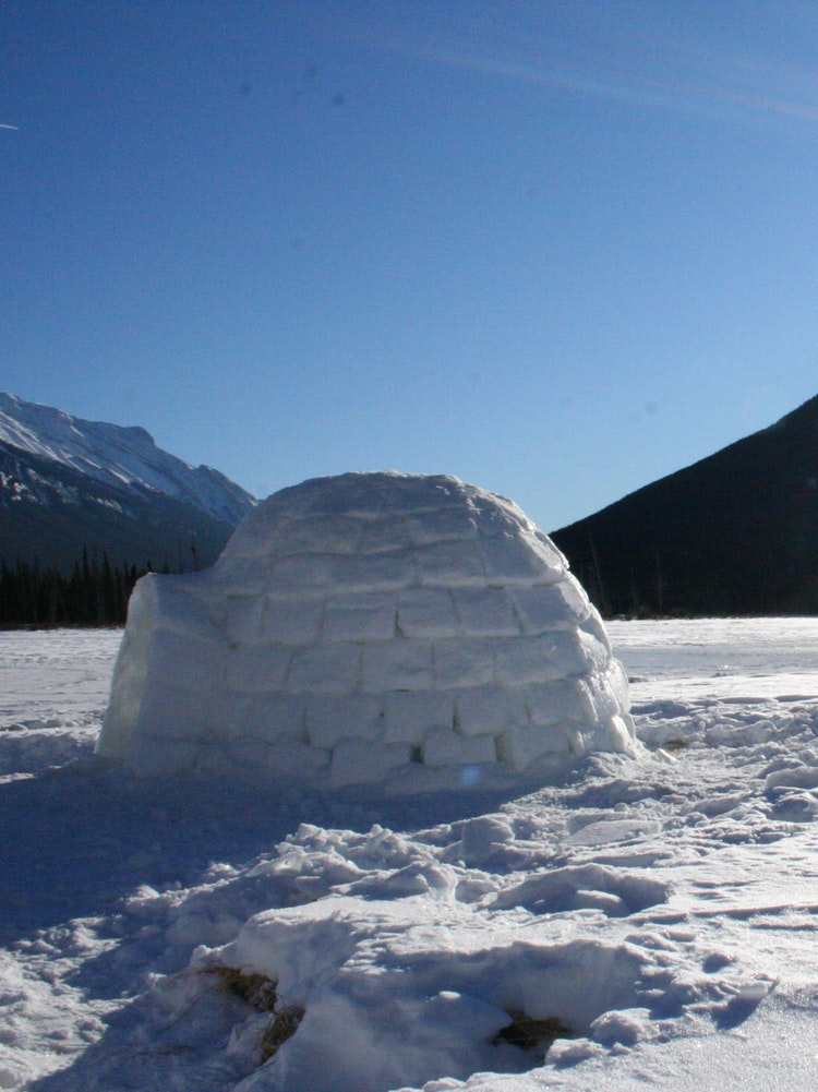Improvised igloo building on the Vermillion Lakes outside Banff, Alberta Canada.