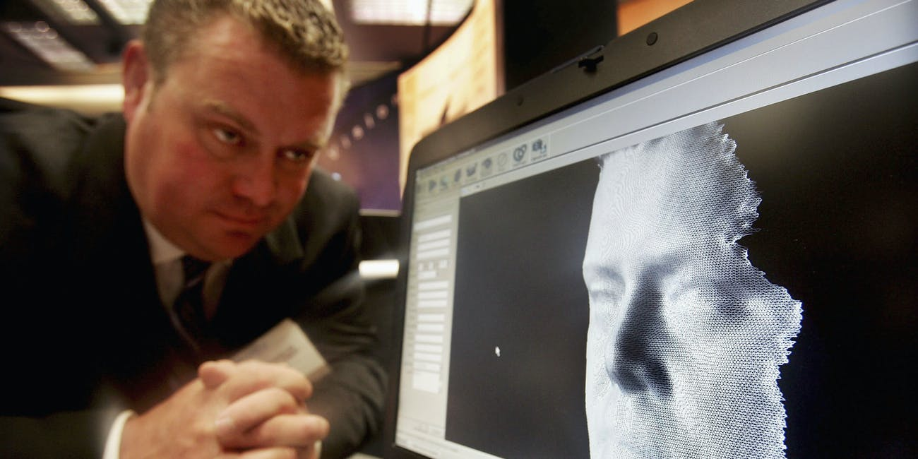 A 3D facial recognition program is demonstrated during the Biometrics 2004 exhibition and conference October 14, 2004 in London. The conference will examine the role of new technology such as facial recognition and retinal scans to determine identity to improve security.