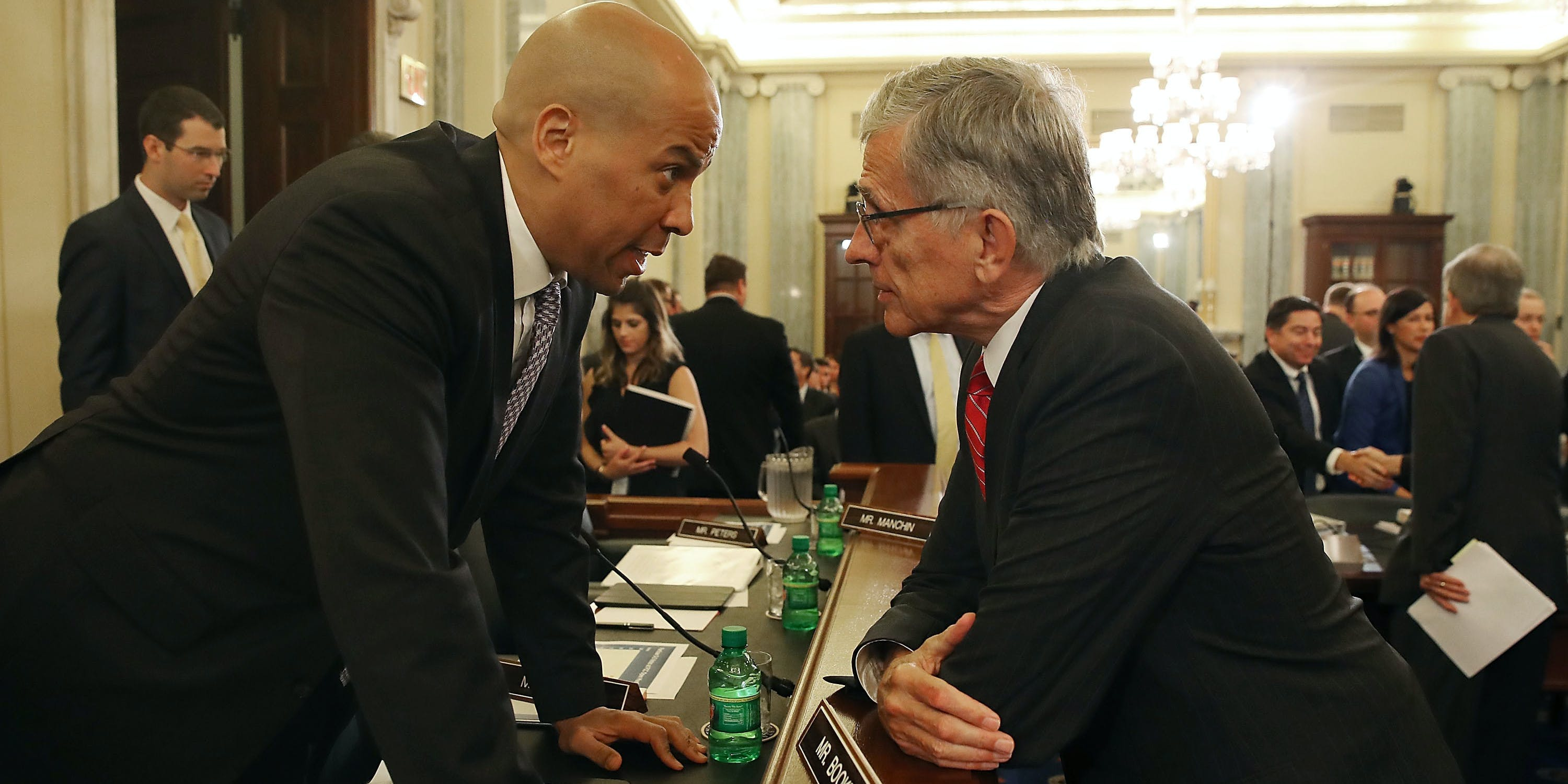 FCC Chairman Tom Wheeler (R), talks with Sen. Cory Booker (D-NJ), before the start of a Senate Commerce, Science and Transportation Committee hearing on Capitol Hill, September 15, 2016 in Washington, DC. The committee heard testimony on oversight of the Federal Communications Commission.