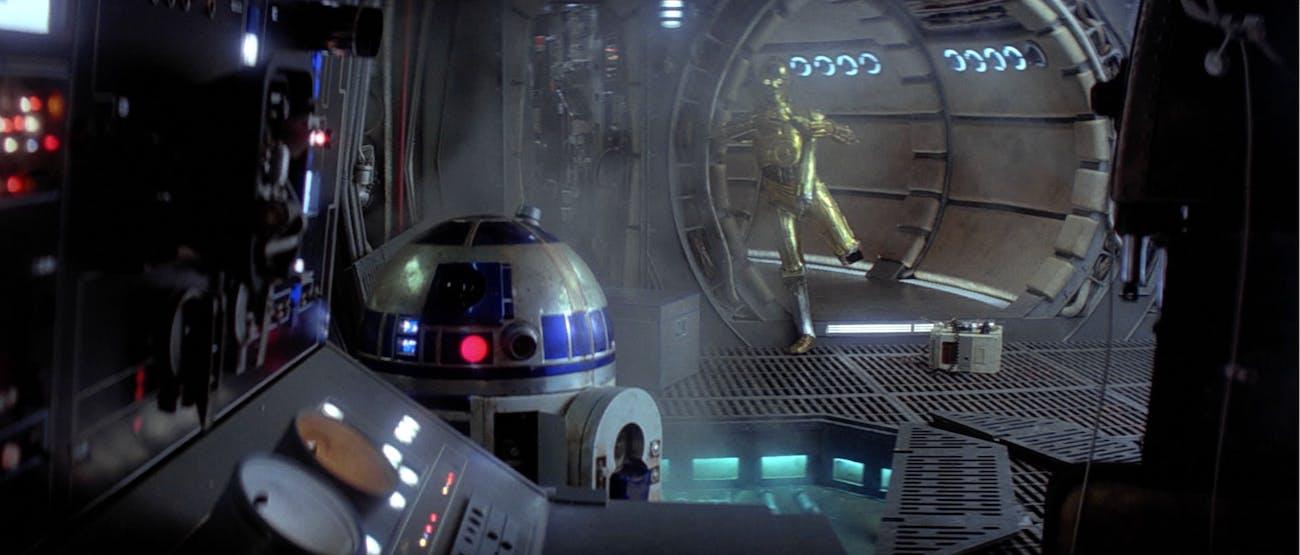 R2-D2 repairs the Millennium Falcon in 'Empire Strikes Back'.