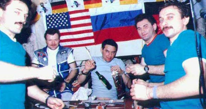 The party bus of space was the Mir station, as these cosmonauts know as they drink cognac and float in 1997.