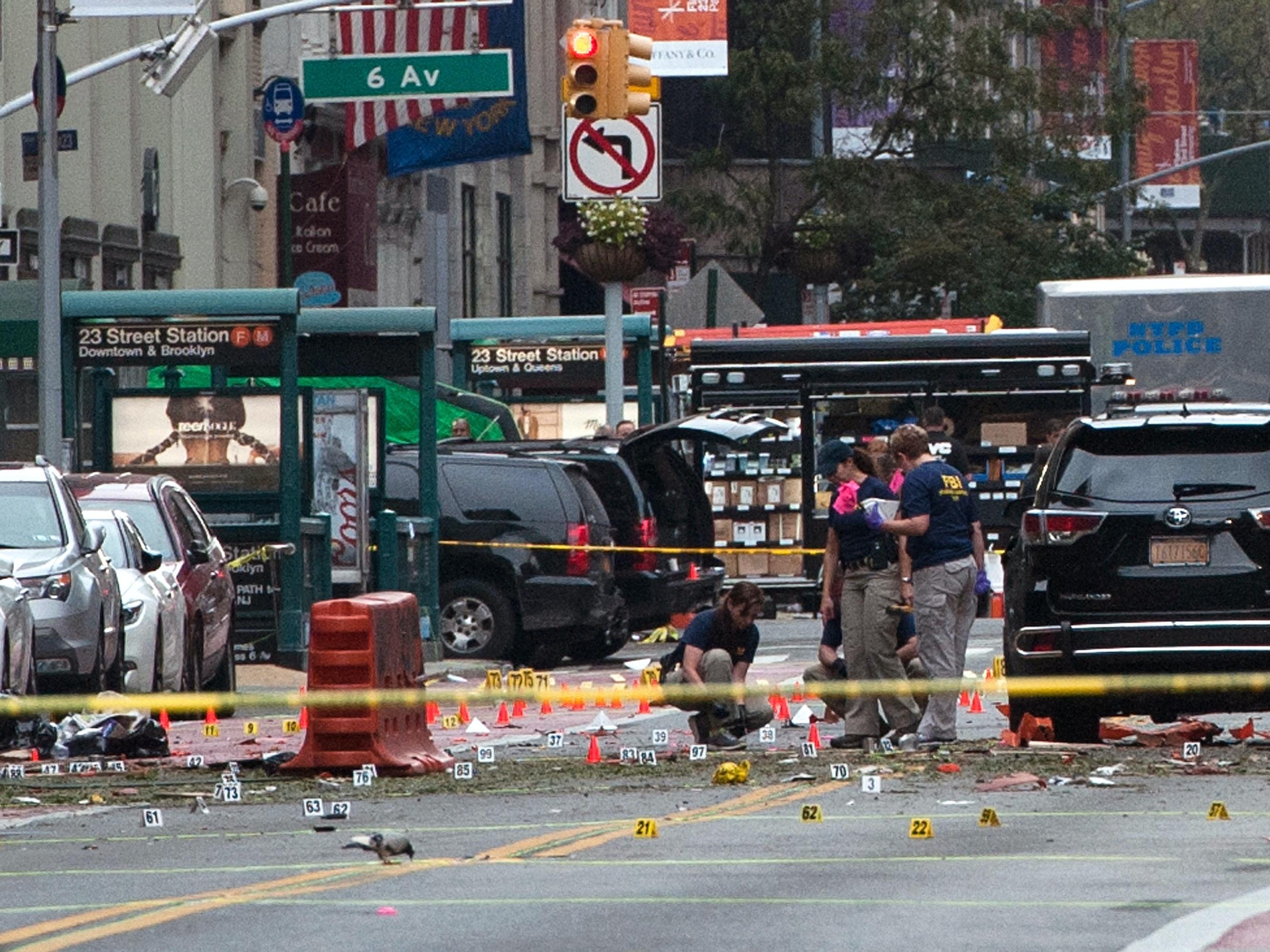 FBI agents review the crime scene of remnants of bomb debris on 23rd St. in Manhattan's Chelsea neighborhood on September 18, 2016 in New York City.